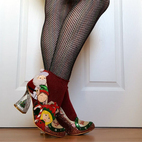 legs wearing festive shoes with Christmas character applique down side