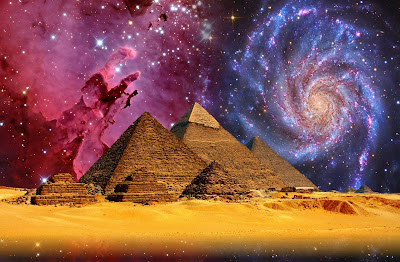 A group of pyramids on a sandy landscape and a star-filled sky.