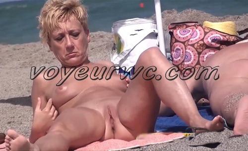 Nude sun tanning women a beach spy cam (BeachVoyeur 18-21)