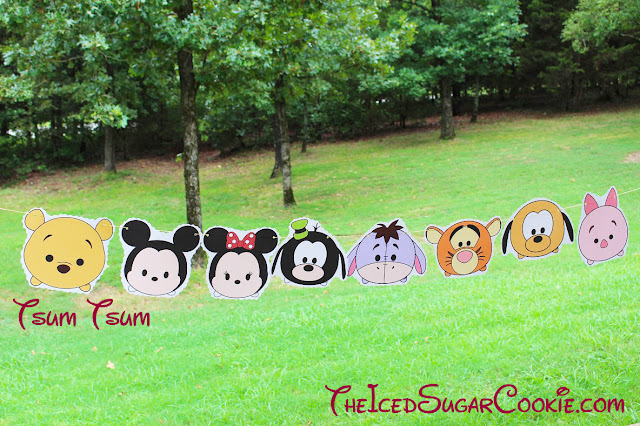 DIY Birthday Party Printable Tsum Tsum flag hanging banner diy ideas for a Disney birthday party Winnie the pooh bear mickey mouse minnie mouse Pluto eyeore tigger goofy piglet The Iced Sugar Cookie