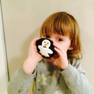 Having fun motor skills practice making penguin cupcakes