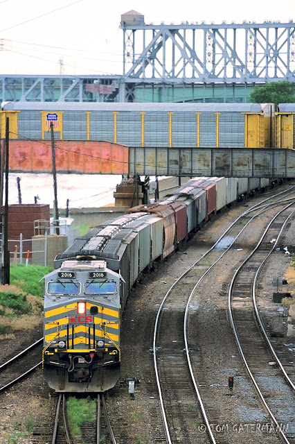 KCS 2016 leads a grain train under BNSF's Hannibal Bridge.