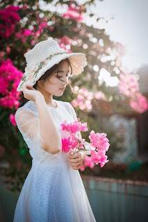 Beautiful-Girl-in-White-Dress-Holding-Beautiful-Pink-Flowers