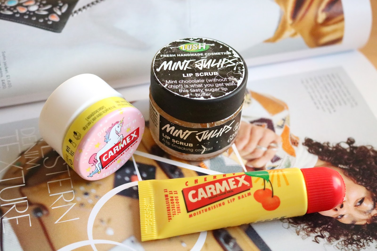 lush mint julips lip scrub, carmex cherry tube and carmex sugar plum lip balm