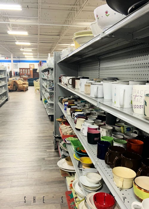 Thrift store shelves stocked with dishes at Thrift Smart in Nashville.