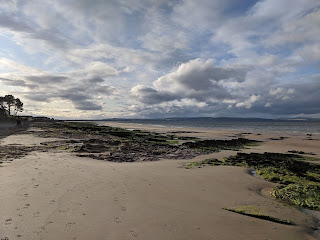Nairn central beach at low tide looking over firth towards Cromarty