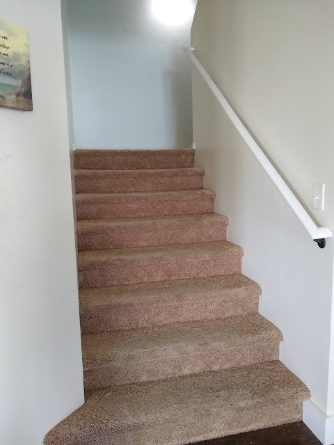 Old stairs with carpet