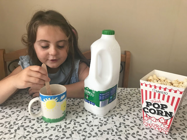 Arla Goodness milk, popcorn, hot chocolate , family night in