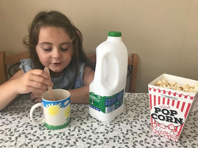 Arla Goodness milk, popcorn, hot chocolate , family night in