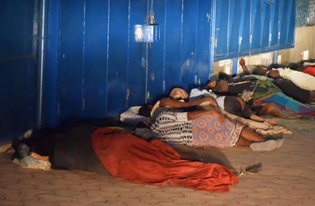Kenyans who were late on the curfew hours sleeping on the streets. PHOTO | NMG