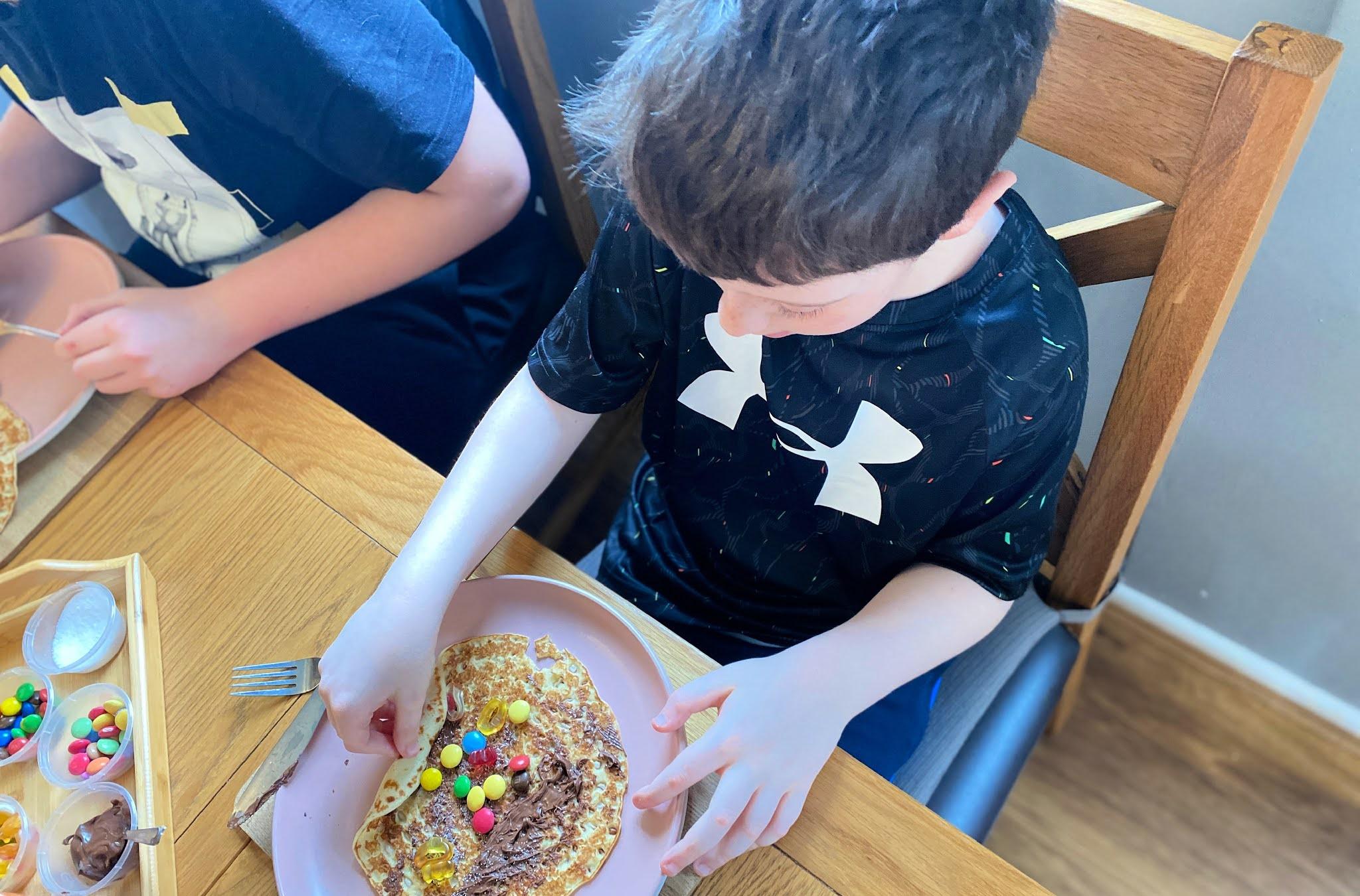 boy making pancakes