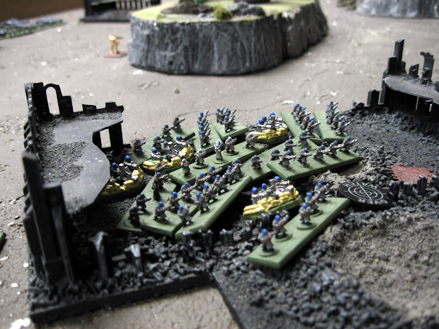 Heavy weapon teams hold down a ruin.