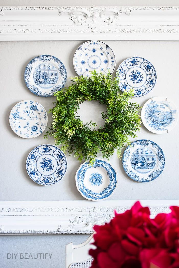 plate wreath hung inside open frame