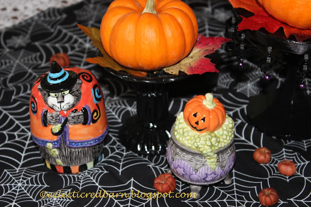 Eclectic Red Barn: Candlesticks with small pumpkins and Halloween salt and pepper shakers