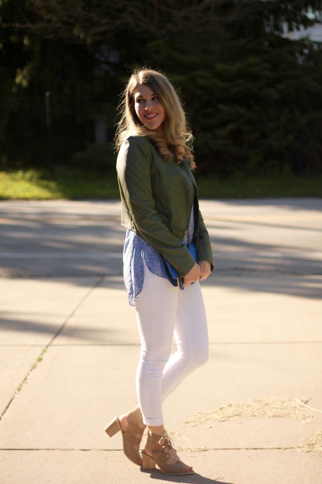 Stylus 3/4 sleeve peasant shirt blue geo, white jeans, olive green moto jacket, lace up sandals, Clare V. clutch, casual spring outfit