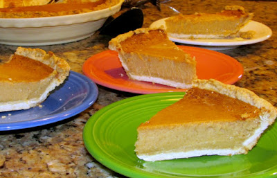 slices of honey chess pie served on various colors of fiesta dishes