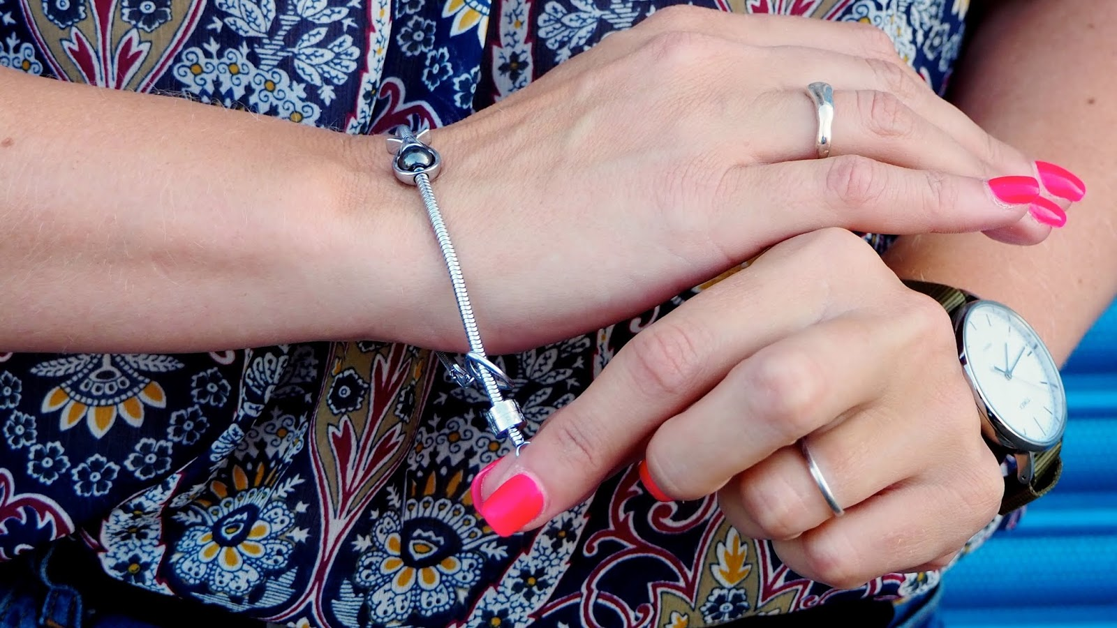 stainless steel bracelet with a fish charm