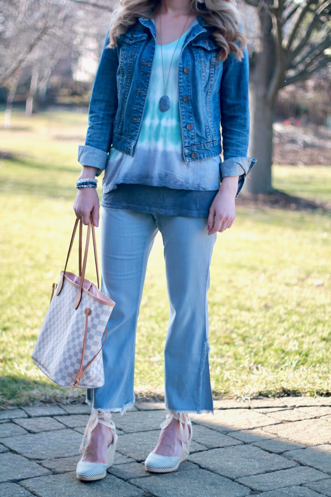 XCVI tie dye, tie dye for spring, tie dye tank top, denim jacket, blue flare crop pants, lace up wedges, pink ankle pants, OTS tie dye top, black and white tie dye top, distressed denim, peep toe booties