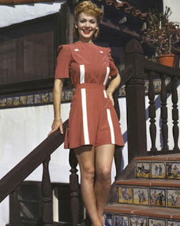 Carole Landis On The Stairs