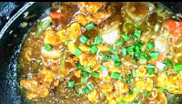 Chilli chicken gravy topped with spring onions