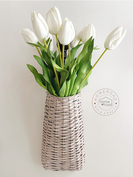 basket of white long stemmed tulips