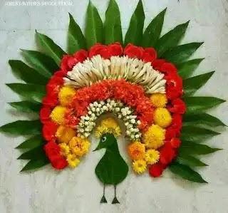 flower rangoli made up of peacock