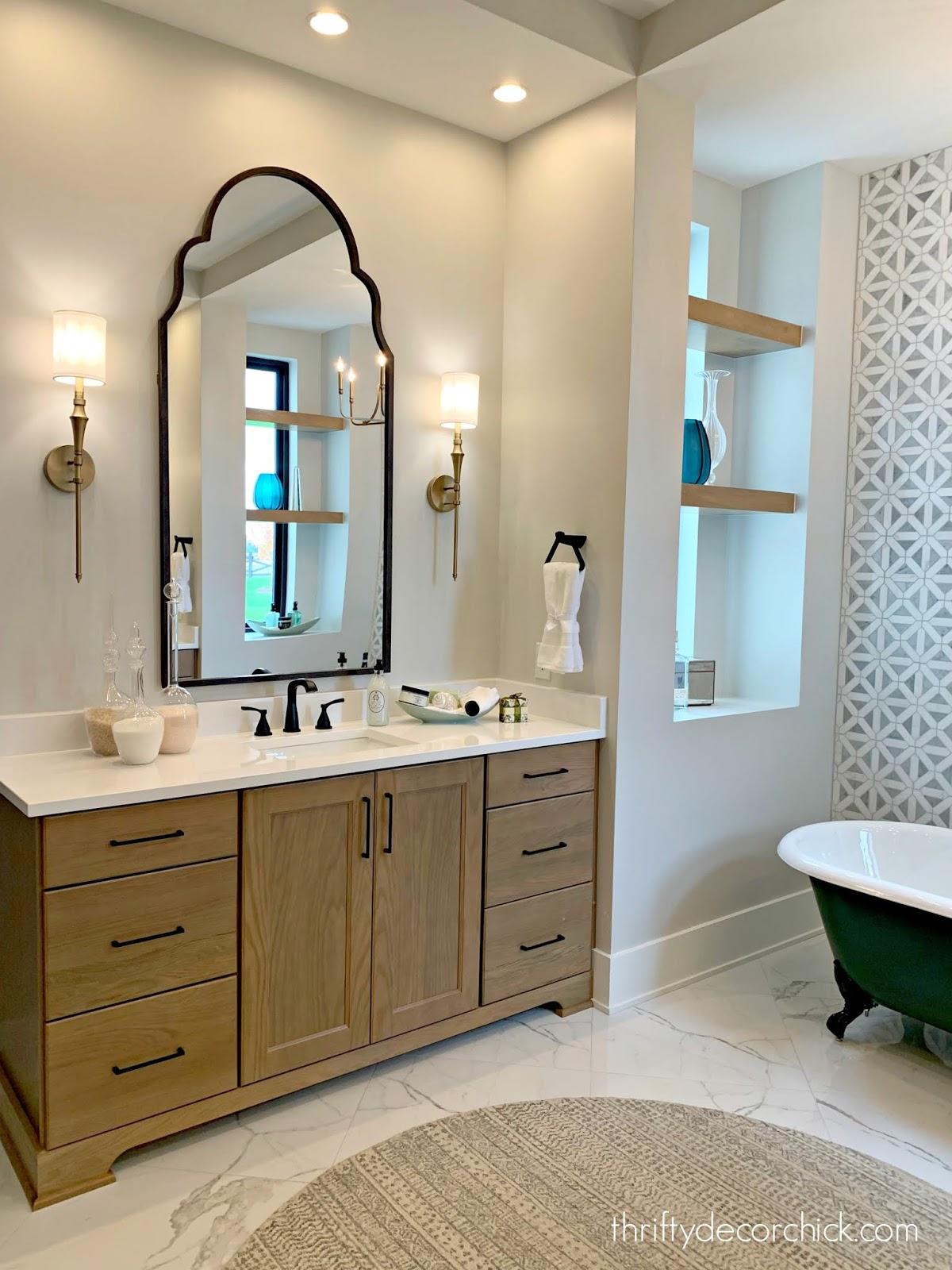 Light wood cabinets black mirror bathroom