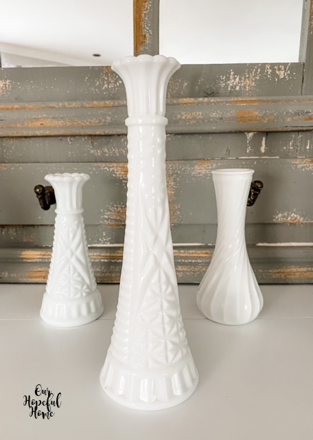 three milk glass bud vases display