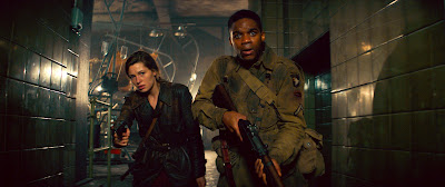 Mathilde Ollivier and Jovan Adepo in Overlord (2018)