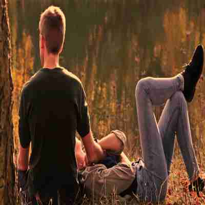 two friends relaxing in a garden