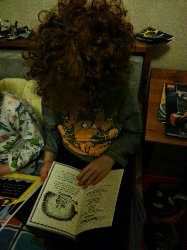 6 year old boy reading Mr Pattacake and the Pirates by Stephanie Baudet