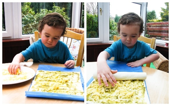 Making vegan pesto cheese swirls - Step 2 - Boy spreading cheese on pastry
