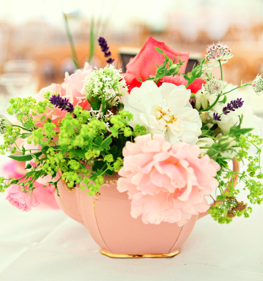 colourful flowers in a pink vintage teapot