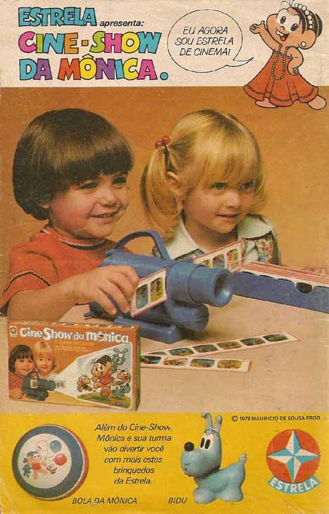 Propaganda antiga de brinquedo da Turma da Mônica com um pequeno projetos e slides