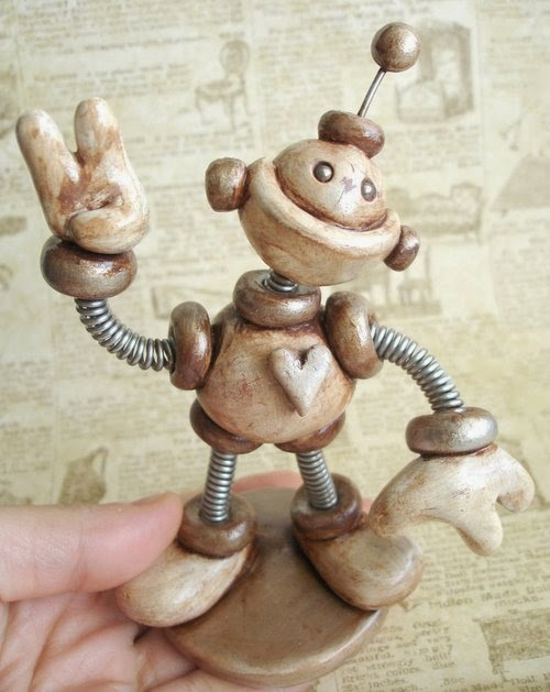 16-Sepia-Sam-HerArtSheLoves-Clay-Robot-World-Sculptures-www-designstack-co