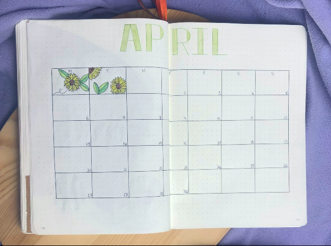 Blank april calendar with sunflowers drawn into empty days