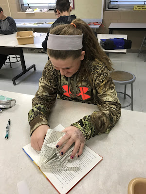 girl creating weeded book art