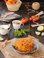 Buñuelos de maíz con crème frâiche y mermelada de pimientos