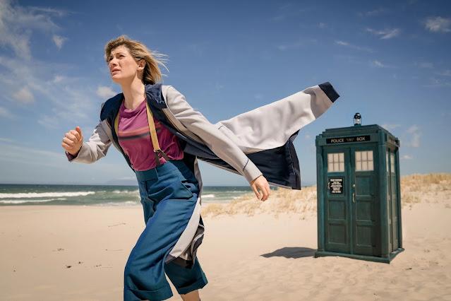 Jodie Whittaker's Doctor runs towards danger, the TARDIS behind her