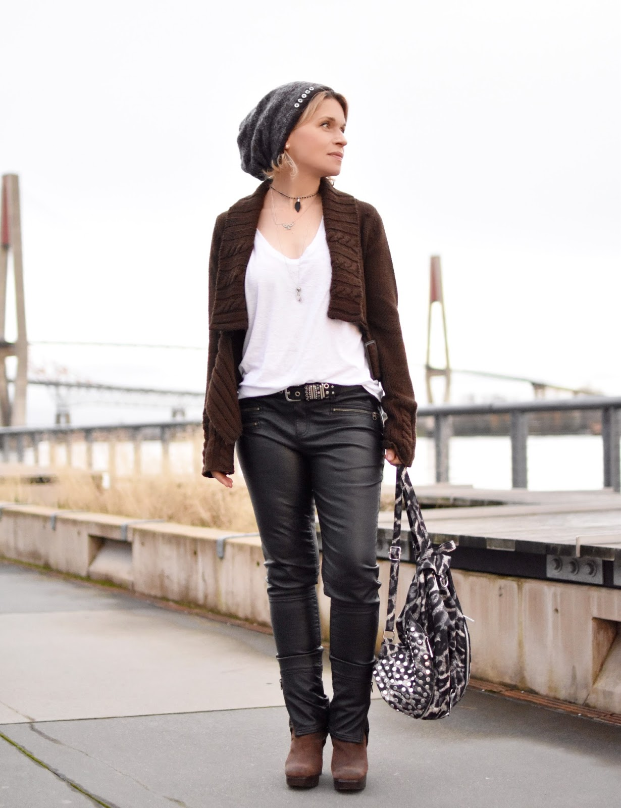 "Monika Faulkner outfit inspiration - styling a slouchy white tee, vegan leather jeans, cropped ""moto"" cardigan, Frye harness boots, and mohair beanie"
