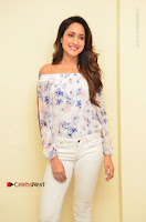 Actress Pragya Jaiswal Latest Pos in White Denim Jeans at Nakshatram Movie Teaser Launch  0017.JPG