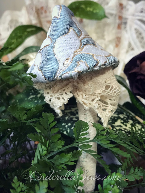 Cinderella Inspired Mushroom Textile Art - This lovely decorative mushroom is completely hand sewn and symbolizes the story of Cinderella. For anyone who loves fairy tales and fantasy art! CLick for the story and more information about the artist #art #textileart #fiberart #handsewing #artist #cinderella #enchantedforest #onceuponatime #fairytale #mushroom