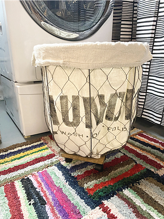 rolling laundry basket with stencil