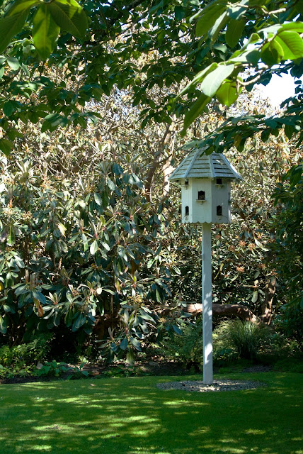 dovecote surrounded by rhododendrons