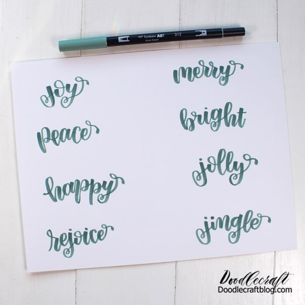 Step 1: Hand Lettering Begin by lettering some Christmas words on the paper with the Dual Brush Pen 312. I just eyeballed the spacing and it worked out perfectly!