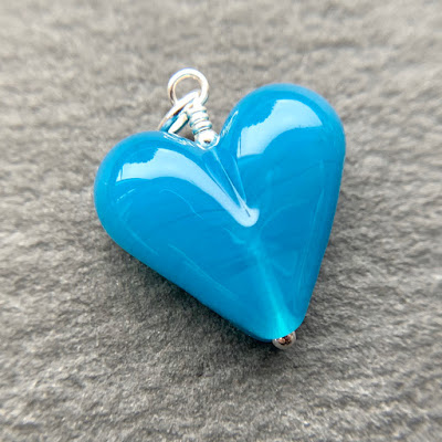 Handmade lampwork glass heart bead pendant by Laura Sparling made with CiM Surf's Up