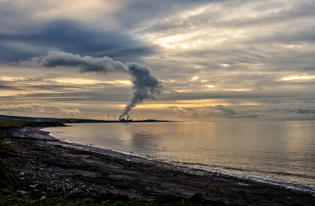 Photo of looking in the opposite direction along Maryport shore towards Iggesund paperboard factory