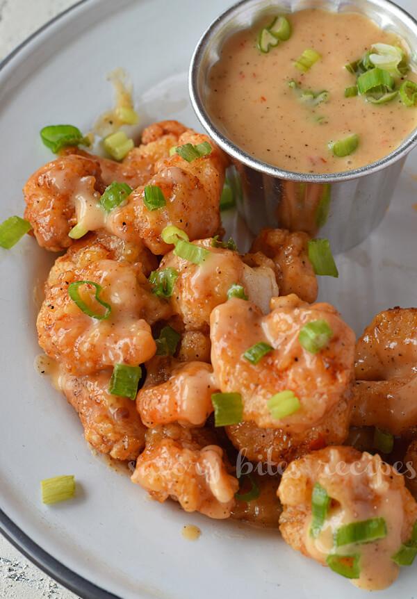 close up of a white plate with bonefish grill copycat bang bang shrimp