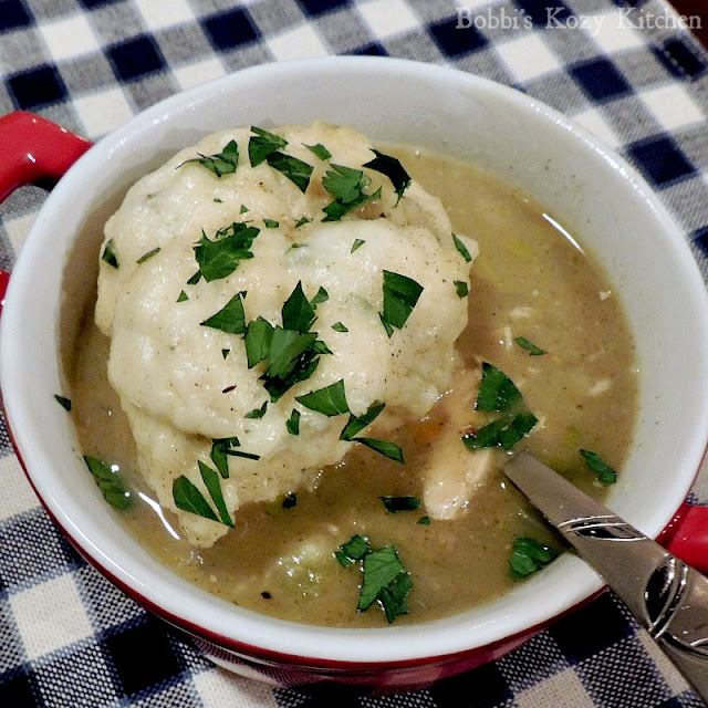 Chicken with Herbed Dumplings from www.bobbiskozykitchen.com