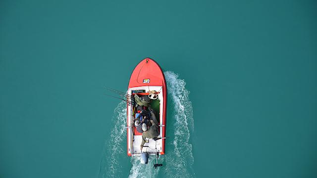 motorboat cutting through blue water
